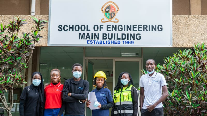 Zambia Flying Labs standing in front of the School of Engineering Building